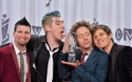 Marianas Trench pose with the Juno after winning group of the year at the 2013 Juno Awards in Regina on Sunday, April 21, 2013. THE CANADIAN PRESS/Liam Richards