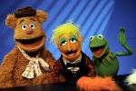 FILE - In this Nov. 24, 2008 file photo, Muppets Fozzie Bear, left, a Whatnot, center, and Kermit the Frog make a television appearance in New York. (AP Photo/Richard Drew, File