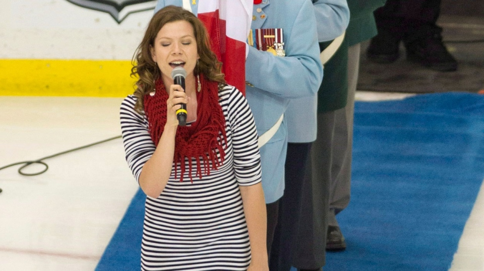 Alexis Normand struggles with the American national anthem during the opening ceremonies of the Memorial Cup game between the Halifax Mooseheads and Portland Winterhawks in Saskatoon, Sask. on Saturday, May 18, 2013. (Liam Richards / THE CANADIAN PRESS)