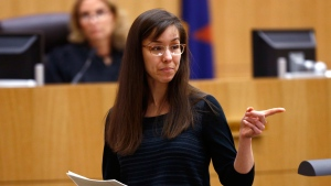 Jodi Arias points to her family as a reason for the jury to give her a life in prison sentence instead of the death penalty on Tuesday, May 21, 2013, during the penalty phase of her murder trial at Maricopa County Superior Court in Phoenix.  (The Arizona Republic, Rob Schumacher, Pool)