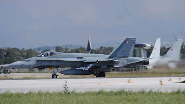 A CF-188 Hornet prepares to take off from Canadian Forces Base Bagotville in Trapani, Italy on Wednesday, March 23, 2011.