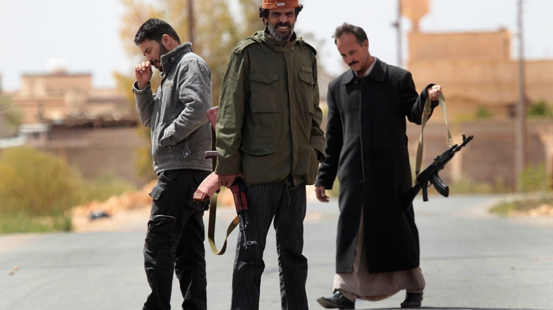 In this image taken during an organized trip by the Libyan authorities, Libyan supporters of Moammar Gadhafi are seen with their new weapons in Ban-Waled, home of the Warfallah tribe, 160kms (100 miles) south east of Tripoli, Libya, Wednesday March 23, 2011. (AP / Jerome Delay)
