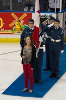 Alexis Normand smiles after singing the Canadian national anthem before the London Knights and Halifax Mooseheads take the ice in Memorial Cup action in Saskatoon, Sask. on Tuesday, May 21, 2013. (Liam Richards. / THE CANADIAN PRESS)