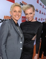 "Ellen DeGeneres, left, and Portia de Rossi arrive at the season 4 premiere of ""Arrested Development"" at the TCL Chinese Theatre on Monday, April 29, 2013 in Los Angeles. (John Shearer / Invision)"