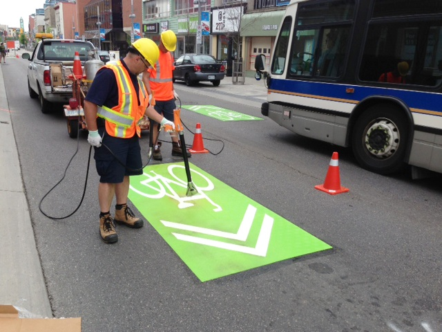 Workers install bike sharrows on King Street in downtown Kitchener on Wednesday, May 22, 2013. (Phil Molto / CTV Kitchener)