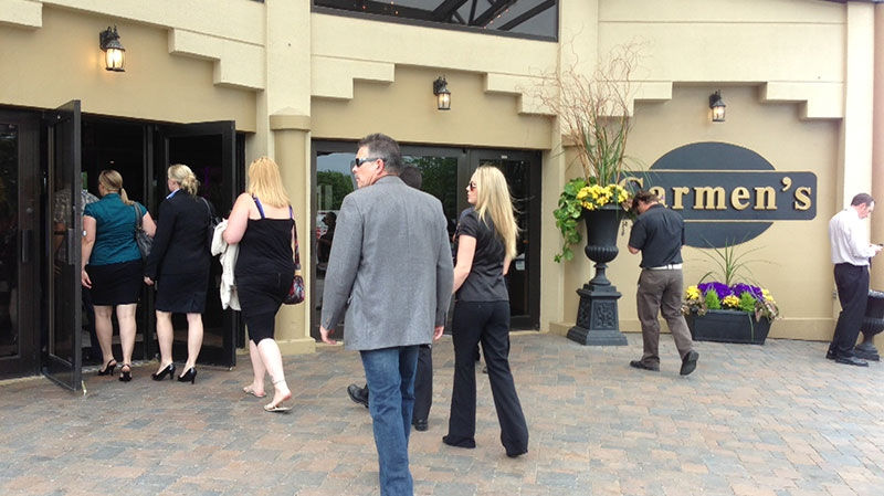 Mourners arrive for the memorial of Tim Bosma at Carmen's Banquet Hall in Hamilton, Ont., Wednesday, May 22, 2013. (Byron Auburn / CTV Toronto)