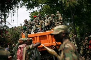 M23 rebels sit in a vehicle as they withdraw from the eastern Congo town of Goma in this Dec. 1, 2012 file photo. (AP / Jerome Delay)