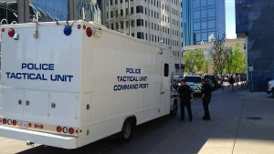 Members with the EPS Tactical Unit on the scene of a reported hostage-taking at the Edmonton Law Courts Wednesday, May 22.