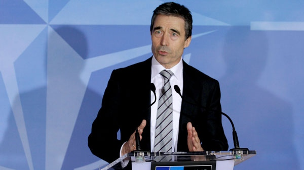 NATO Secretary General Anders Fogh Rasmussen addresses the media at NATO headquarters in Brussels, Thursday, March 24, 2011. (AP Photo / Yves Logghe)
