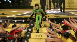 Danica Patrick greets fans after being introduced for the NASCAR All-Star auto race at Charlotte Motor Speedway in Concord, N.C., Saturday, May 18, 2013. (AP Photo/Chuck Burton)