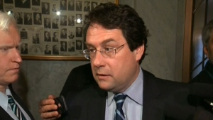 Bernard Drainville, a Parti Quebecois cabinet minister, speaks to the media, Wednesday, May 22, 2013.
