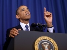 U.S. President Barack Obama reacts as his speech is interrupted by CODEPINK founder Medea Benjamin, Thursday, May 23, 2013, at the National Defense University at Fort McNair in Washington. (AP / Pablo Martinez Monsivais)
