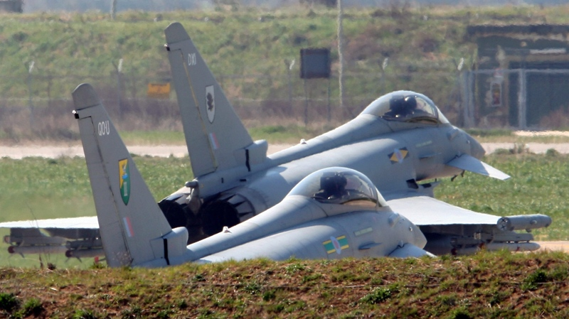 FILE - Two British RAF Typhoon jets prepare to take off from Gioia del Colle air base, near Bari, Italy, Thursday, March 24, 2011. (AP / Donato Fasano)