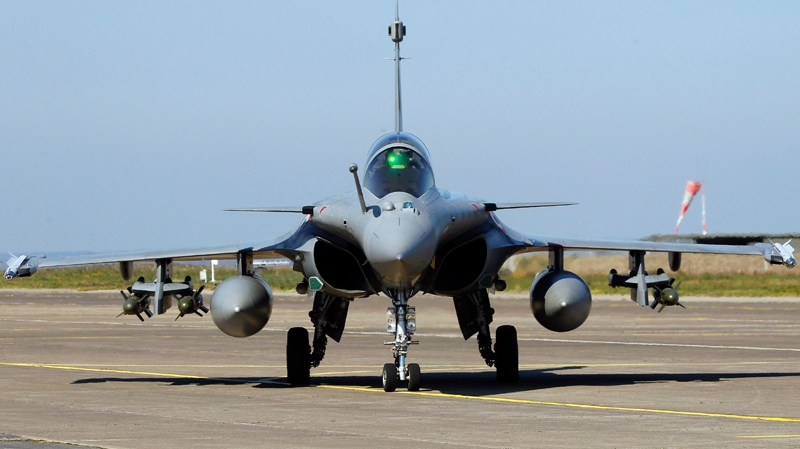 French Air Force Rafale jet fighter comes back from a mission to Libya, at Solenzara 126 Air Base, Corsica island, Mediterranean Sea, Thursday, March 24, 2011. One of the two missiles at right under the wing has been used during the mission according to the pilot with no other details available. (AP / Francois Mori)