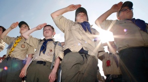 Boy Scouts salute early Saturday morning, May 21, 2011 during New Jersey's Boy Scouts Camporee in Sea Girt, N.J. (AP / Mel Evans, file)