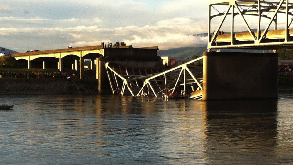 People look on after the Interstate 5 bridge collapsed over the Skagit River in Mount Vernon, Wash., Thursday, May 23, 2013. (The Seattle Times, Rick Lund)