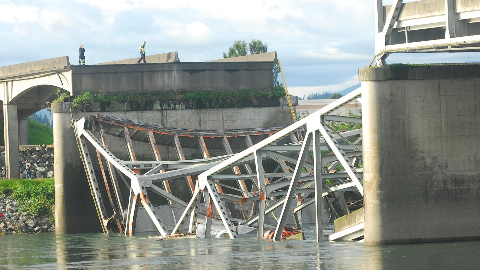 A portion of the Interstate 5 bridge is submerged after it collapsed into the Skagit River dumping vehicles and people into the water in Mount Vernon, Wash., Thursday, May 23, 2013. (Skagit Valley Herald / Frank Varga)