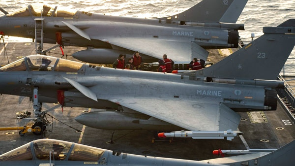 In this photo provided by the French Army, French Navy Rafale jet fighters sit on the deck of Charles de Gaulle aircraft carrier in the Mediterranean Sea, Wednesday, March 23, 2011. (AP / Raphael Martinez)