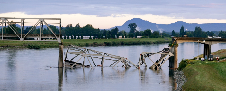 A collapsed portion of the Interstate 5 bridge lies in the Skagit River, in Mount Vernon, Wash., Friday, May 24, 2013.  (AP / Elaine Thompson)