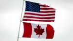 An American and Canadian flag are seen in this undated file photo. (Darryl Dyck / THE CANADIAN PRESS)