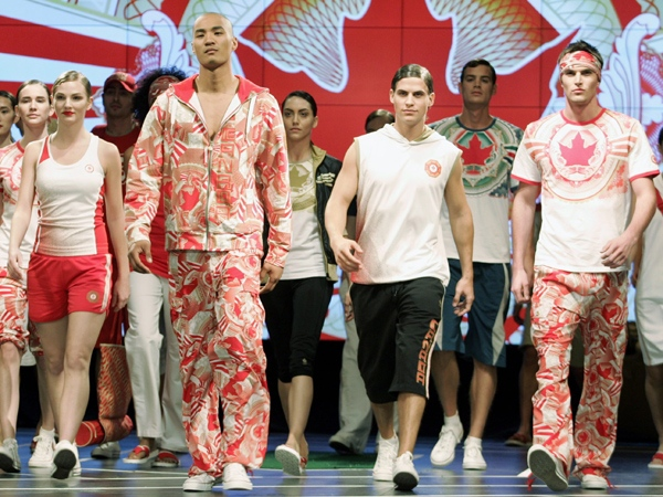 Models and Olympic athletes model Canadian Olympic replica wear, which will be worn by Canada's Olympic athletes at the Beijing games, during a fashion show in Toronto, Wednesday, April 30, 2008. (J.P. Moczulski / THE CANADIAN PRESS)