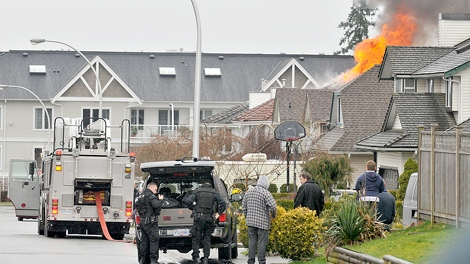 Emergency response teams surrounded the scene of a Surrey house fire after a shooting on March 24, 2011. (Evan Seal/Surrey-North Delta Leader)