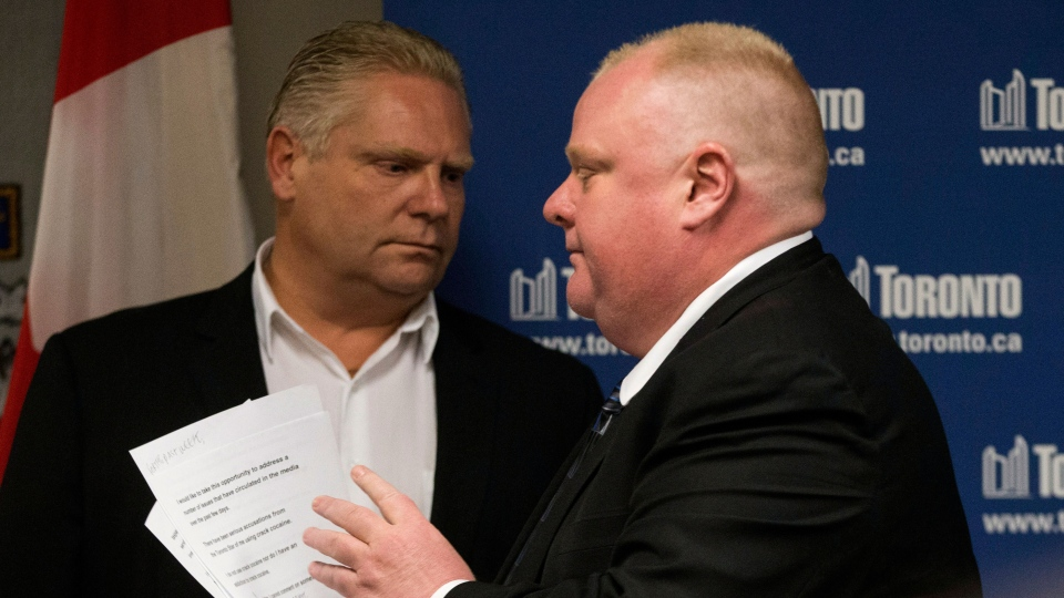 Toronto Mayor Rob Ford (right) walks past his brother Doug after reading a statement to the media in Toronto on Friday, May 24, 2013. (Chris Young / THE CANADIAN PRESS)