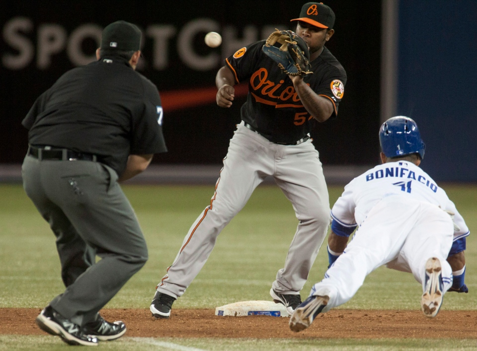 Toronto Blue Jays' Emilio Bonifacio slides, attempting to steal second base but is tagged out by Baltimore Orioles' Yamaico Navarro during MLB action in Toronto, Friday, May 24, 2013. (Jesse Johnston / THE CANADIAN PRESS)