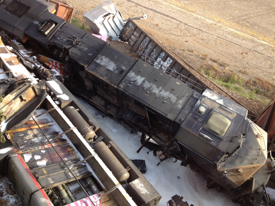 Damaged railcars lie on the ground near Rockview, Mo. on Saturday, May 25, 2013. (KFVS, Michael Mohundro)