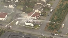 Emergency response teams surrounded the scene of a Surrey house fire after a shooting on March 24, 2011. (CTV)