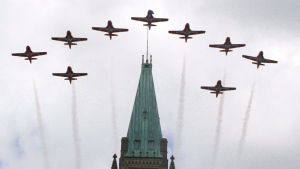 The aerobatic Snow Birds fly over the Peace Tower on Parliament Hill as part of the Canada Day celebrations in Ottawa on July 1, 2012. (Fred Chartrand / THE CANADIAN PRESS)