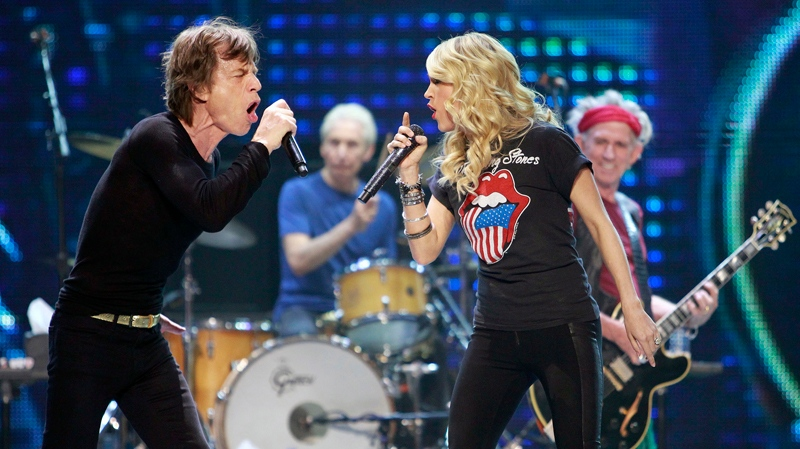 Carrie Underwood sings it's 'Only Rock'n Roll' with Mick Jagger of the Rollings Stones at the Air Canada Center, in Toronto, on Saturday, May 25, 2013. (AP / The Buffalo News, Harry Scull Jr.)