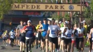 Runners leave the Stampede grounds at the start of the 49th annual Scotiabank Calgary Marathon