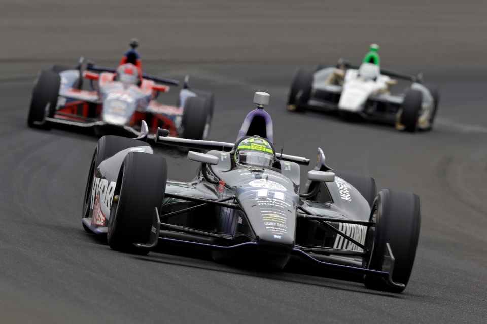 Tony Kanaan, of Brazil, drives through the first turn during the Indianapolis 500 auto race at the Indianapolis Motor Speedway in Indianapolis, Sunday, May 26, 2013. (AP / Tom Strattman)