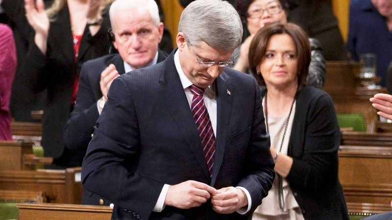 Prime Minister Stephen Harper votes against a Liberal contempt of Parliament motion in the House of Commons on Parliament Hill in Ottawa, Friday March 25, 2011. (Adrian Wyld / THE CANADIAN PRESS)