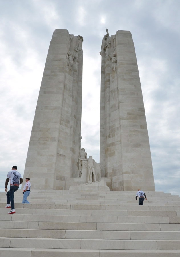 Two member of a cycling team of Canadian veterans, taking part in a tour to raise awareness of mental health issues in the military, ascend the steps of the Canadian National Vimy Memoral at Vimy Ridge, France, on Sunday, May 26, 2013. (Murray Brewster / THE CANADIAN PRESS)