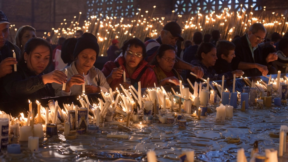 People light candles at the Basilica of the National Shrine of Our Lady of Aparecida, in the town of Aparecida, Brazil, Sunday, May 26, 2013. (AP / Andre Penner)