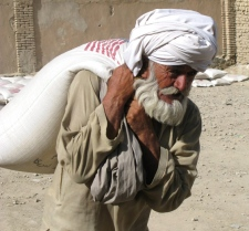 A local resident of Kandahar city heads home with a sack of wheat during a United Nations food distribution program on Tuesday, April 29, 2008. (THE CANADIAN PRESS / James McCarten)