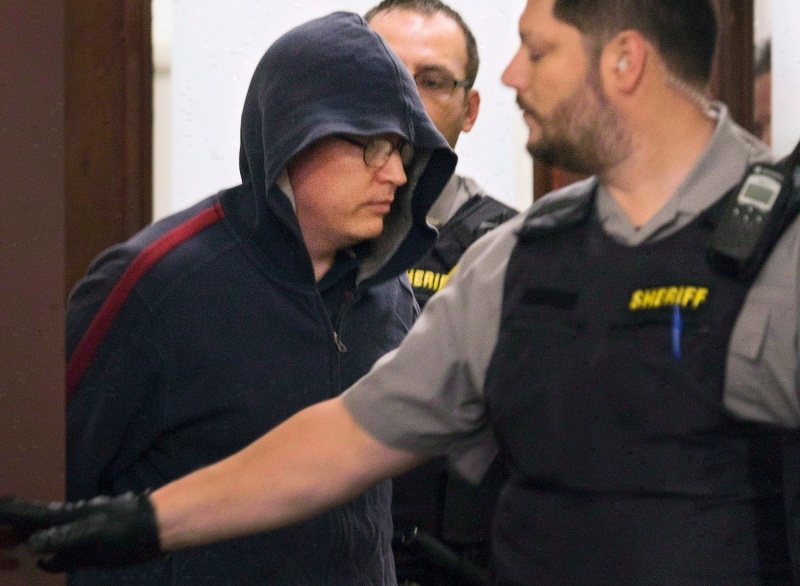 Jeffrey Paul Delisle leaves court in Halifax on Oct. 10, 2012. (Andrew Vaughan / THE CANADIAN PRESS)