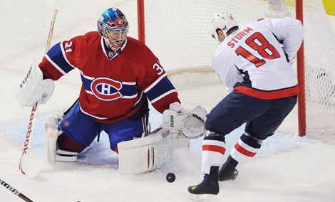 Montreal Canadiens goaltender Carey Price makes a save against Washington Capitals' Marco Sturm during first period NHL hockey action in Montreal on Saturday, March 26, 2011. The CANADIAN PRESS/Graham Hughes
