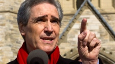 Liberal leader Michael Ignatieff speaks to reporters on Parliament Hill as he makes his opening remarks of the campaign, in Ottawa, Saturday, March 26, 2011. (Ryan Remiorz / THE CANADIAN PRESS)