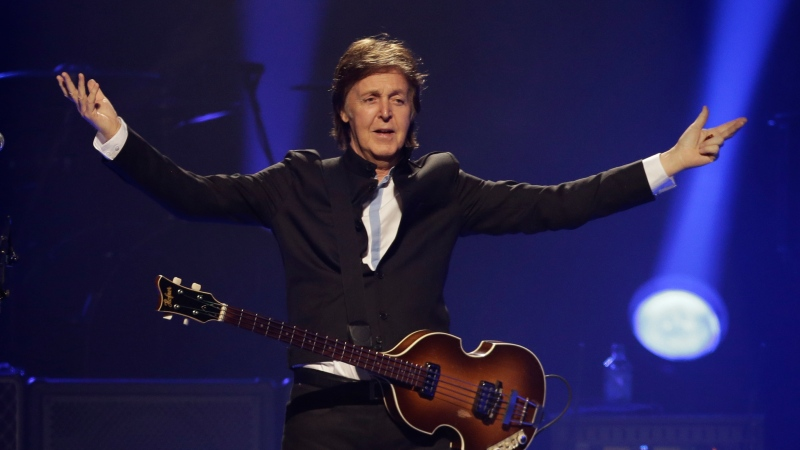 "Paul McCartney performs during the first U.S concert of his ""Out There"" tour, in Orlando, Fla., in this Saturday, May 18, 2013 file photo. (AP / John Raoux)"