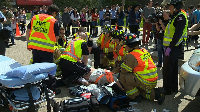 Students in south Edmonton watched Monday as two pedestrians were struck by a distracted driver in a parking lot during the lunch hour - in a simulated crash scene driving home the message about the dangers of distracted driving.