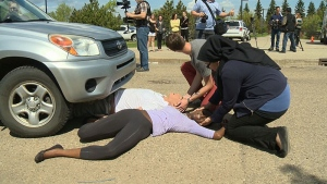 Distracted driving, mock collision