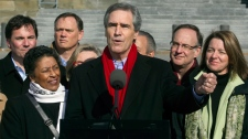 Liberal leader Michael Ignatieff speaks to reporters on Parliament Hill as he launches his campaign surrounded by candidates on Saturday, March 26, 2011 in Ottawa. (Ryan Remiorz / THE CANADIAN PRESS)