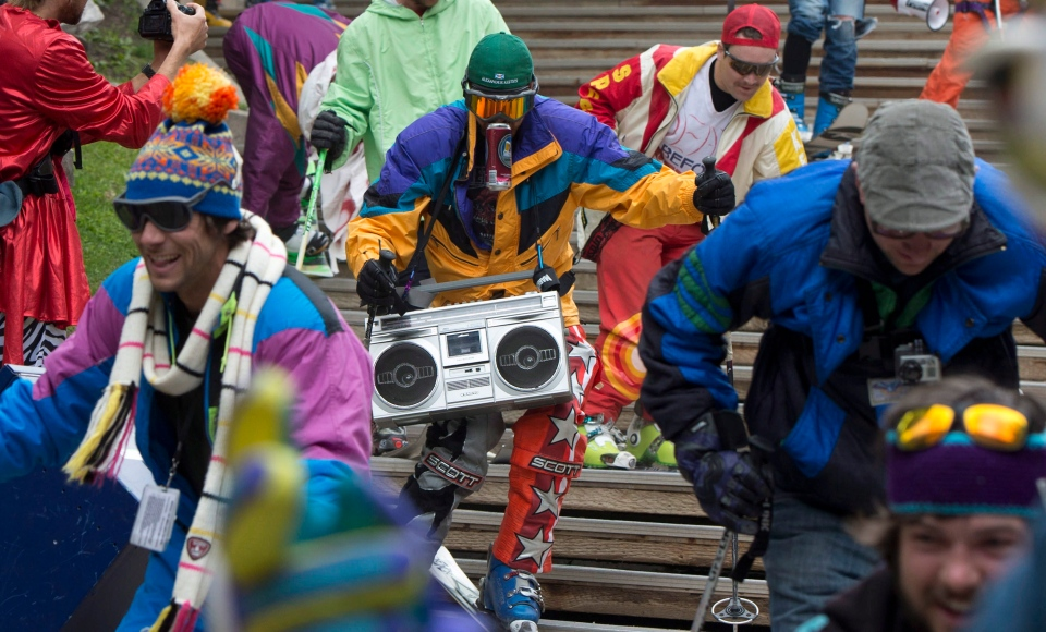 Skiers and snowboarders dressed up in costumes ski a set of stairs at the base of Blackcomb mountain in Whistler, B.C. Monday, May 27, 2013. (Jonathan Hayward / THE CANADIAN PRESS)