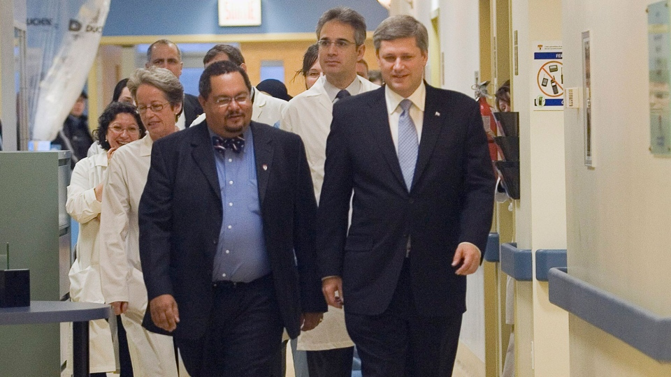Prime Minister Stephen Harper, right, chats with Dr. Arthur Porter, left, at the Montreal General hospital in Montreal Friday Nov. 24, 2006. (Ryan Remiorz / THE CANADIAN PRESS)