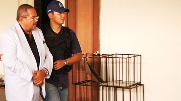 Arthur Porter is led away in handcuffs after being arrested in Panama on Monday May 27, 2013