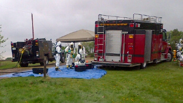 A clandestine lab team investigates the discovery of unknown chemicals on an abandoned homestead near Strasbourg. (RCMP handout)