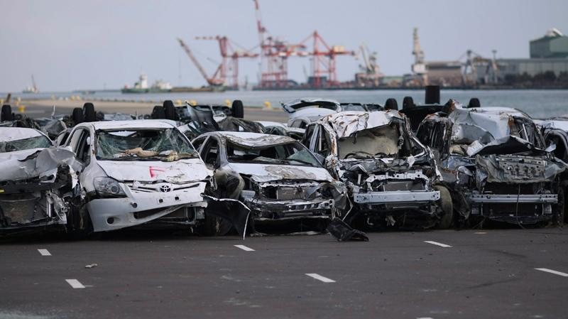 New vehicles damaged by the tsunami waters sit lined in a Toyota parking lot at Sendai port, Miyagi Prefecture, northeastern Japan, Monday, March 28, 2011. (AP / Wally Santana)